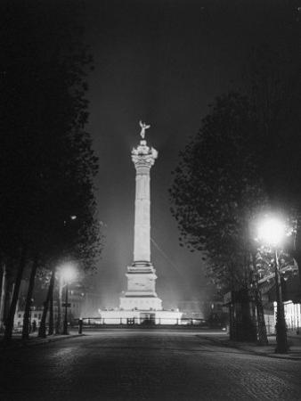 The Place De La Bastille Shimmering with Light During the Night