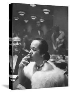 Woman Tries Lady's Cigar in Club After Release of Surgeon General's Report on Smoking Hazards by Ralph Morse