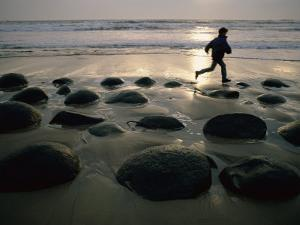 Jogger on a Stony Beach by Randy Olson