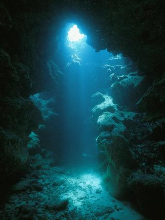 A Beam of Sunlight Illuminates an Underwater Cave