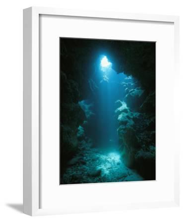 A Beam of Sunlight Illuminates an Underwater Cave