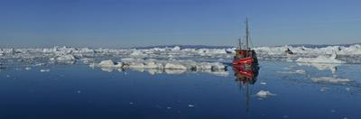 A Boat in An Iceberg Fields Near Ilulissat by Raul Touzon
