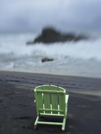 A Green Lounge Chair on a Black Sand Beach
