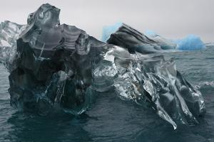 A Large Block of Sculptured Ice Floating on Jokulsarlon Lagoon by Raul Touzon