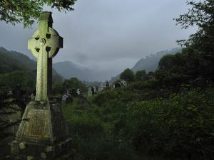 A Large High Cross in the Cemetery in Glendalough by Raul Touzon