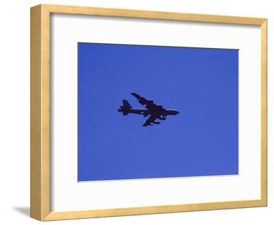 A Military Jet Speeds Through a Clear Blue Sky