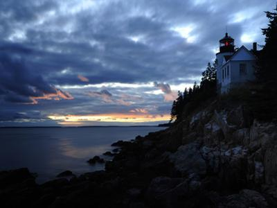 A Moody Sky over Bass Harbor Head Lighthouse at Sunset by Raul Touzon