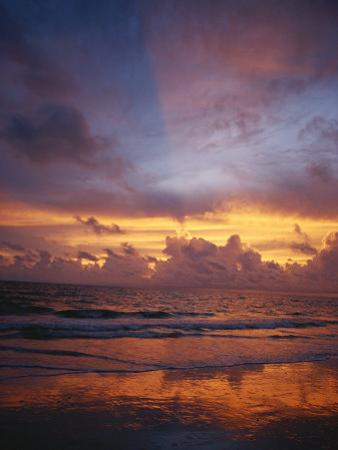 A Multi-Hued Sunset over Marco Island, Florida by Raul Touzon