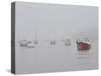 Boats in Rockport Harbor Shrouded in Fog by Raul Touzon