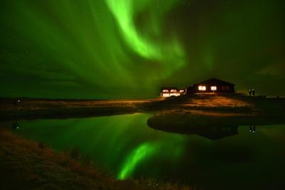 The Aurora Borealis Or Northern Lights Above a Hotel by Raul Touzon