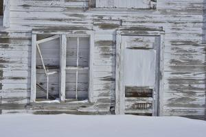 The Wooden Walls and Door of a Dilapidated Barn in Winter by Raul Touzon