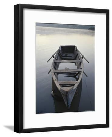 Timeworn Boat Rests on a Calm Lake