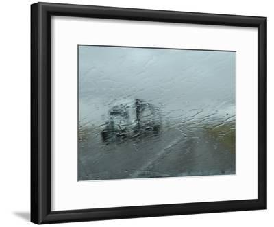 Truck on Route 380 Through a Wet Windshield