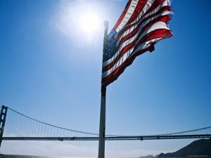 American Flag Flying with the Golden Gate Bridge in Background by Ray Laskowitz