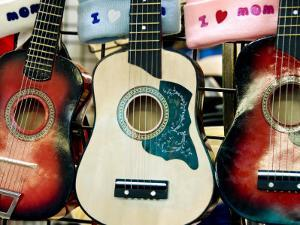 Guitars for Sale at the New Mexico State Fair by Ray Laskowitz