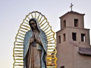 Mother Mary Sculpture with Church Belltower in Background by Ray Laskowitz