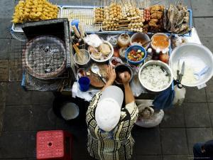 Overhead of Vendor at Street Food Stall by Ray Laskowitz