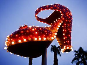 Red Neon Shoe Glowing at Dusk Along Fremont Street by Ray Laskowitz