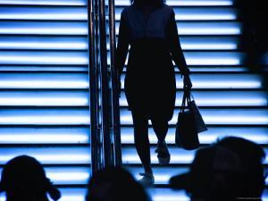 Silhouetted Shoppers Walk Up the Stairs to Park Lane Plaza in Causeway Bay by Ray Laskowitz