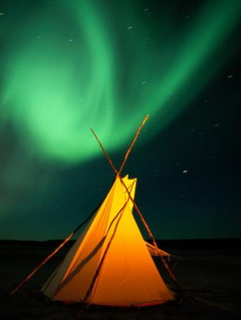 A Solitary Tepee under a Light Streaked Sky from the Aurora Borealis by Raymond Gehman