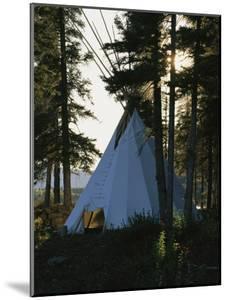 A Tepee is Built on the Edge of Cli Lake by Raymond Gehman