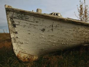 A Wooden Boat Lies Abandoned at the Hay River Shipyard by Raymond Gehman