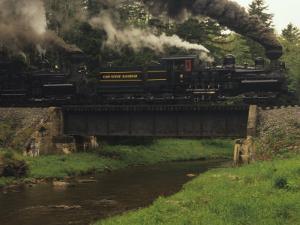 Cass Scenic Railroad Train Crossing a Bridge over a Stream by Raymond Gehman