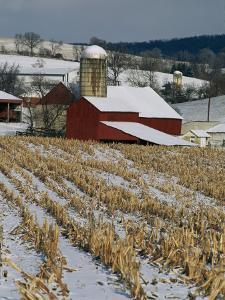 Corn Stubble and Barn in a Wintery Pennsylvania Landscape by Raymond Gehman