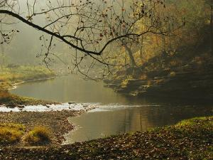 Creek Runs Through Blue Hole Campground by Raymond Gehman