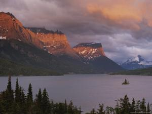 Dawn Strikes the Mountains Rising Above St. Mary Lake by Raymond Gehman