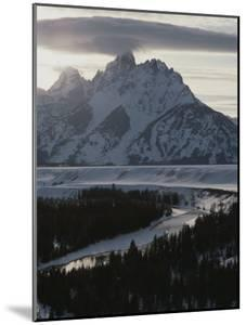 Grand Teton Mountain and the Snake River in Winter by Raymond Gehman