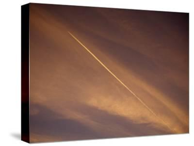 Jet Vapor Trails in the Sky at Twilight