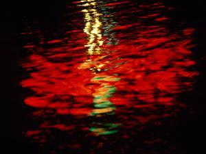 Light Reflected in the Water at Night by Raymond Gehman