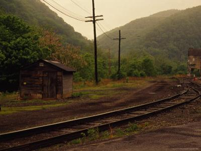 Railroad Through the Old Town of Thurmond, West Virginia by Raymond Gehman