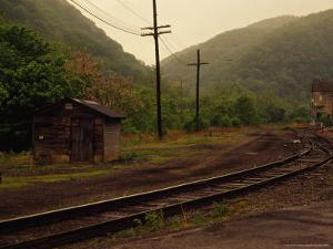 Railroad Through the Old Town of Thurmond, West Virginia by Raymond Gehman