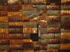 Side of a Building Adorned with Old License Plates by Raymond Gehman