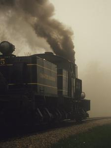 Smoke Billowing from the Engine of a Train on the Cass Scenic Railroad by Raymond Gehman