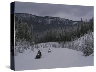 Snowmobilers in Yellowstone National Park, Wyoming