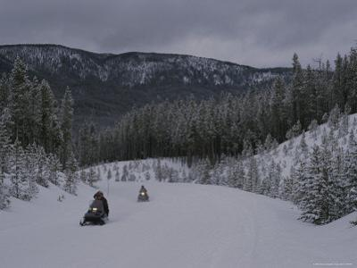 Snowmobilers in Yellowstone National Park, Wyoming by Raymond Gehman