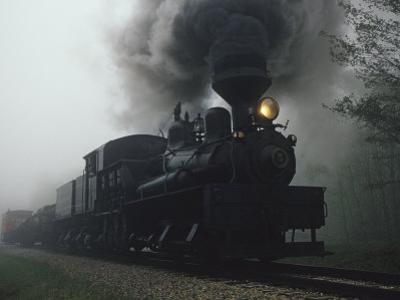 Steam Locomotive Belching Smoke on a Foggy Morning by Raymond Gehman