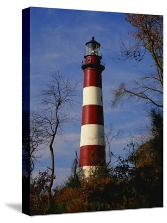 The Assateague Island Lighthouse Against a Blue Sky