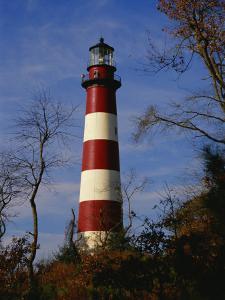 The Assateague Island Lighthouse Against a Blue Sky by Raymond Gehman