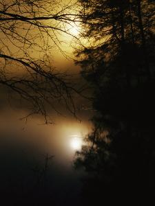 The Morning Sun is Reflected on Otter Lake by Raymond Gehman