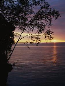The Sun Sets on Lake Superior in the Apostle Islands by Raymond Gehman