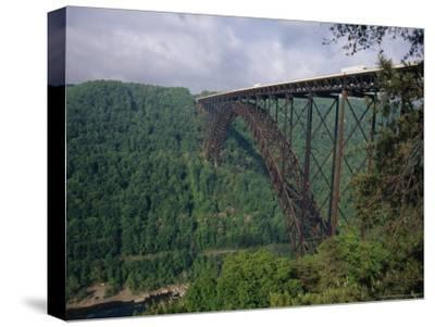 Trucks Passing Over the New River Gorge Bridge