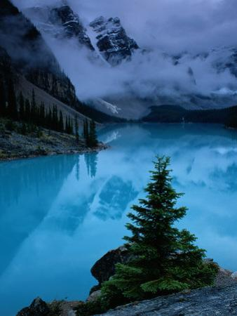 View of Moraine Lake with Low-Lying Clouds at One End by Raymond Gehman