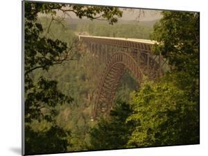 View of the New River Gorge Bridge From One Side by Raymond Gehman