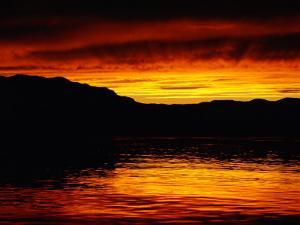 Vivid Sunset over the Mckenzie River by Raymond Gehman