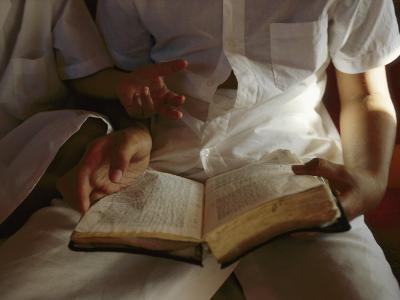 Reading an Old Bible During a Service-Randy Olson-Photographic Print