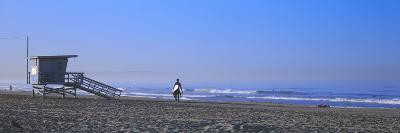 Rear View of a Surfer on the Beach, Santa Monica, Los Angeles County, California, USA--Photographic Print